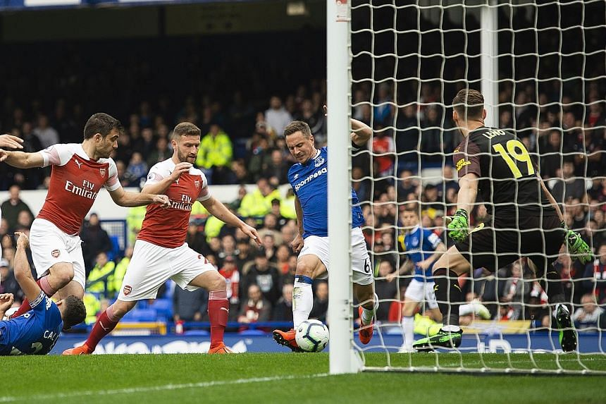 Everton's veteran defender Phil Jagielka, a last-minute pick, beats Arsenal goalkeeper Bernd Leno with a close-range finish in the 10th minute to become the oldest player at age 36 to score in the Premier League this season.