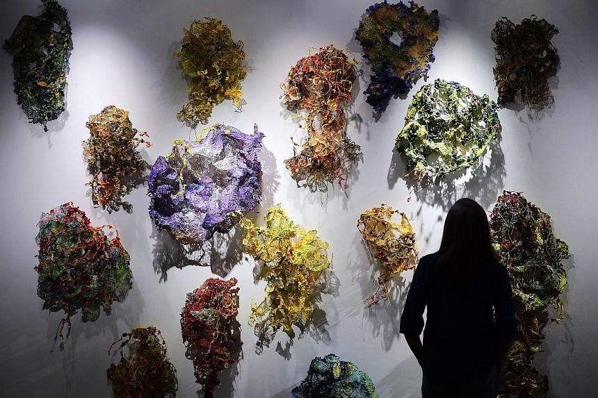 Urban Veil by Nandita Mukand features about 15 colourful works made of cloth stiffened with acrylic, plaster and resin. They are inspired by forms of natural decay.