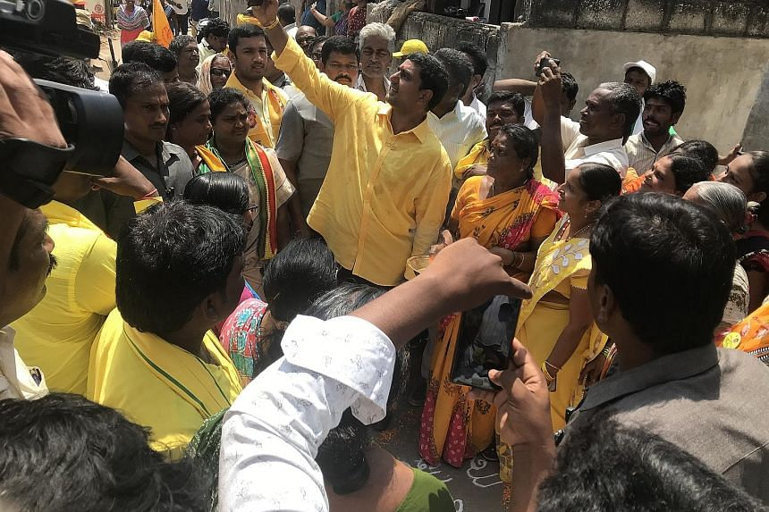 Above: Building works in Amaravati are in various stages of completion. Left: Andhra Pradesh Chief Minister Chandrababu Naidu's son, Mr Nara Lokesh, is contesting in Mangalagiri town for the Telugu Desam Party in Thursday's state assembly elections.