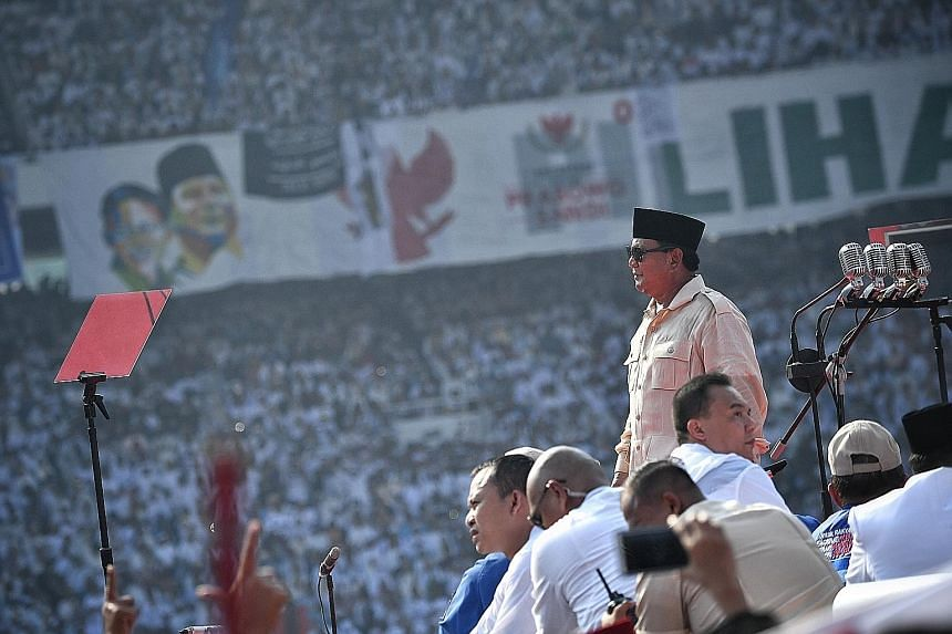 Presidential hopeful Prabowo Subianto speaking to supporters at Jakarta's Gelora Bung Karno stadium yesterday. He said that he is disgusted at how corruption has denied Indonesians the opportunity to prosper.
