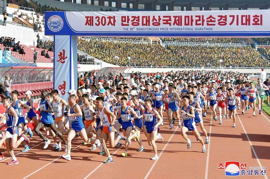 Runners at the Pyongyang marathon yesterday. Although Americans are banned from visiting North Korea, the race saw 950 participants from Western countries, compared with some 450 last year.