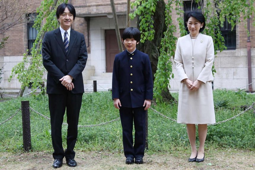 Japan's Prince Hisahito (centre), accompanied by his parents Prince Akishino and Princess Kiko at Ochanomizu University junior high school before attending the entrance ceremony in Tokyo, on April 8, 2019.