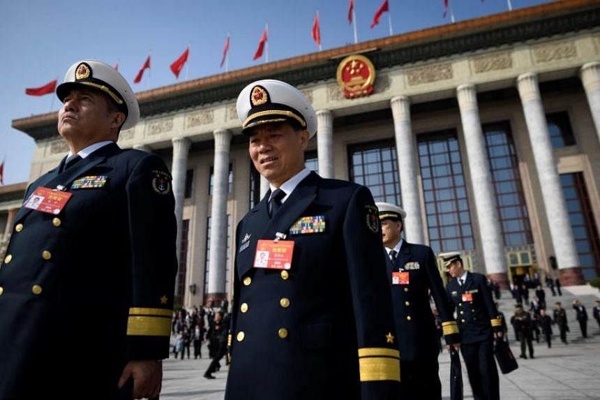 Delegates from the Chinese People's Liberation Army leave the Great Hall of the People after a preparatory meeting the day before the opening session of the National People's Congress in Beijing on March 4, 2019.
