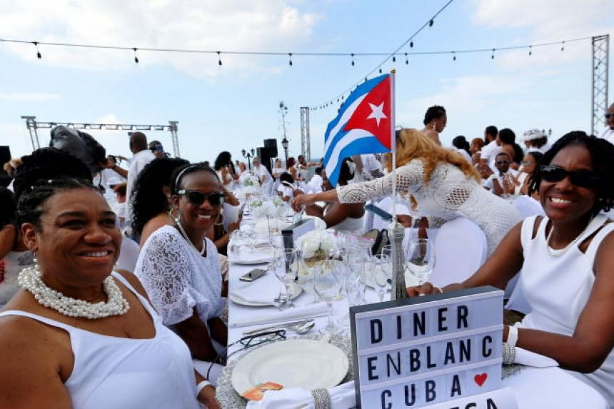 Around 500 people from different countries take part in 'Le Diner en Blanc' (The Dinner in White) held for the first time in Havana, Cuba, on April 6, 2019.