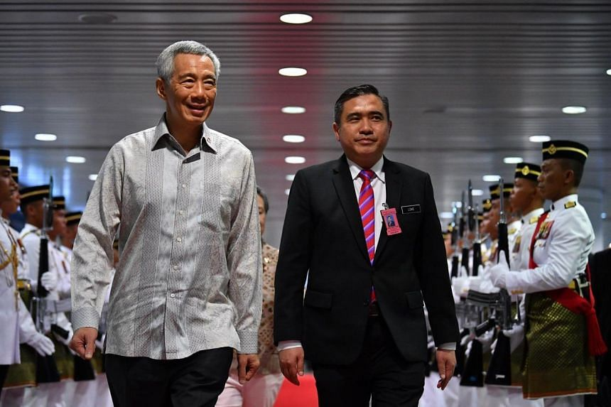 Prime Minister Lee Hsien Loong and Malaysian Transport Minister Anthony Loke walking through the static guard of honour at Kuala Lumpur International Airport on April 8, 2019.