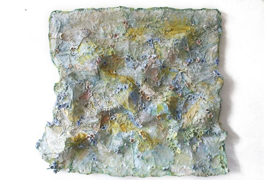 """Each Little Flower That Opens (above), a """"sculptural painting"""" Mukand created from cloth, paper, plaster, wool, resin, paint and wire."""