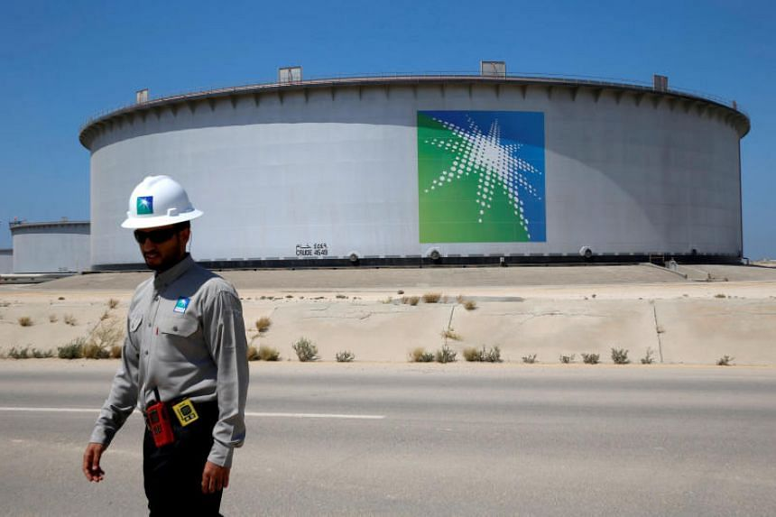 Saudi Aramco's Ras Tanura oil refinery and oil terminal in Saudi Arabia. Although Aramco is state-owned, its finances put it in the same league as independent international oil majors like Exxon and Shell.