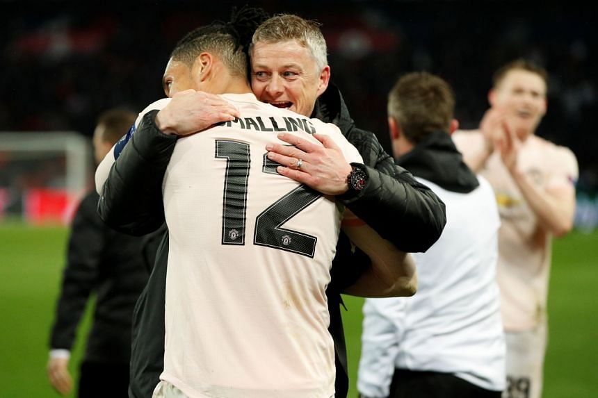 Solskjaer and United's Chris Smalling celebrate after the match against PSG.