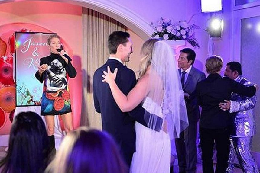 STAR SURPRISE: Did you hire a wedding singer, late-night-show host Jimmy Kimmel asked. 	He gatecrashed the wedding of a couple - whom he identified only as Jason and Kate in an online post - while he was doing a series of shows in Las Vegas. 	The cou