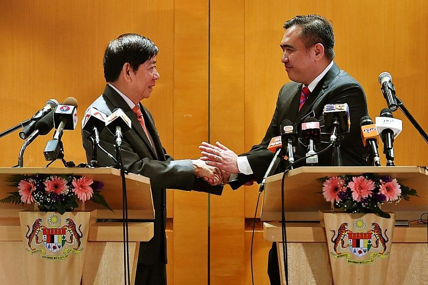 Transport Minister Khaw Boon Wan (left) and Malaysian Transport Minister Anthony Loke at a news conference at the Kuala Lumpur International Airport yesterday after they met to discuss bilateral transport matters. Mr Khaw said both ministries have re