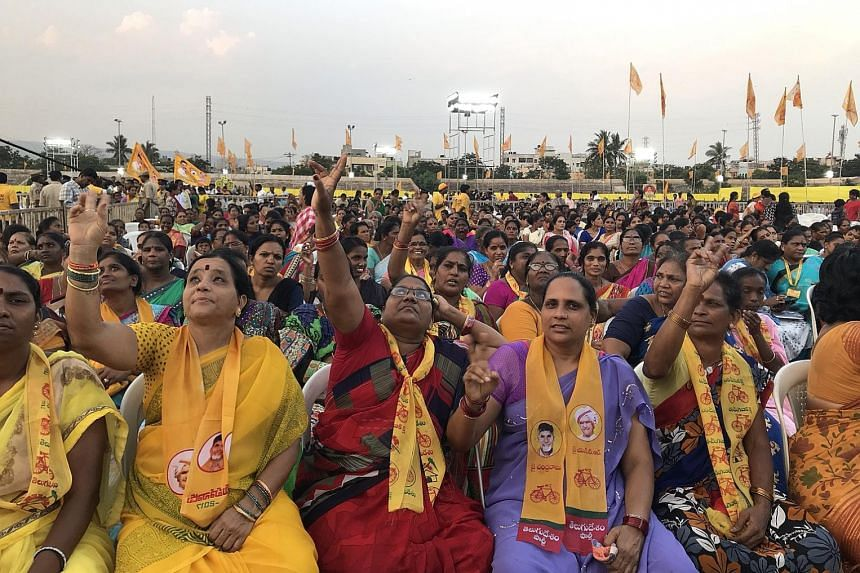 Above: Chief Minister of Andhra Pradesh Chandrababu Naidu and leader of the ruling Telugu Desam Party (TDP) is fighting for his political life against Mr Jagan Mohan Reddy, leader of YSR Congress Party. Left: TDP supporters at a rally in Visakhapatna