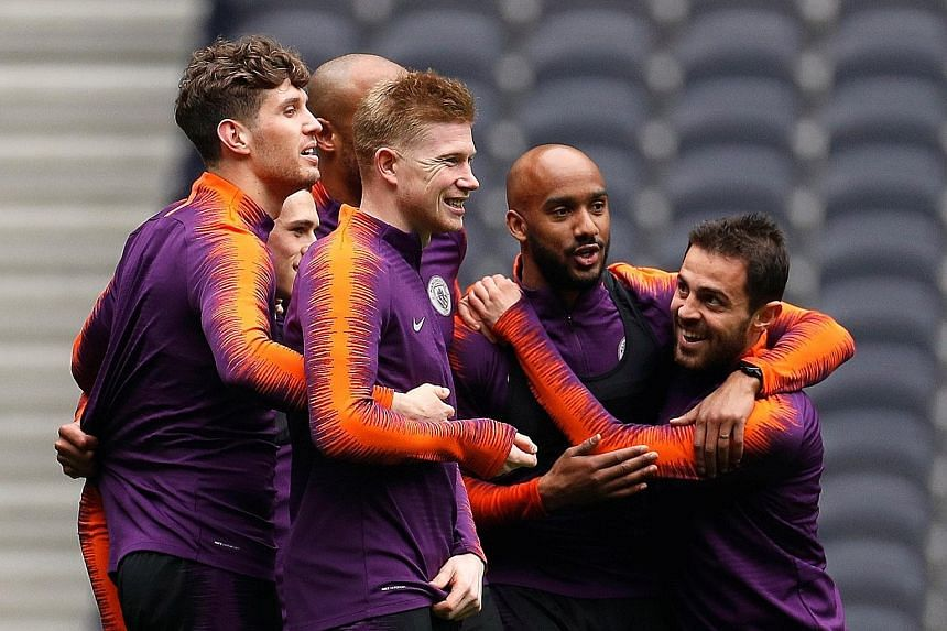Despite Manchester City's hectic schedule, midfielder Kevin de Bruyne (third from right) says the team are taking it one game at a time as they stay on course to win an unprecedented quadruple.