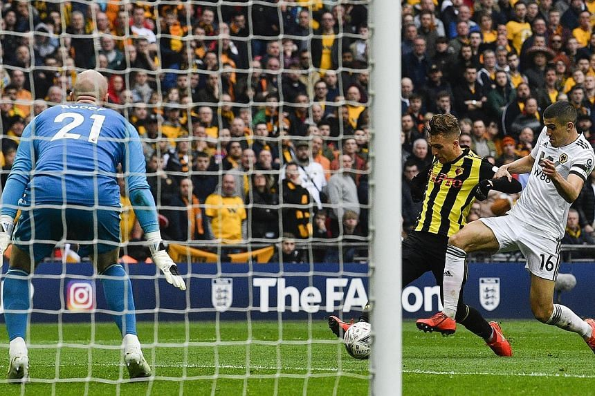Watford winger Gerard Deulofeu holding off Conor Coady to score past Wolves goalkeeper John Ruddy in extra time of their FA Cup semi-final at Wembley on Sunday. Watford's 3-2 win earned them a final showdown against Manchester City on May 18.