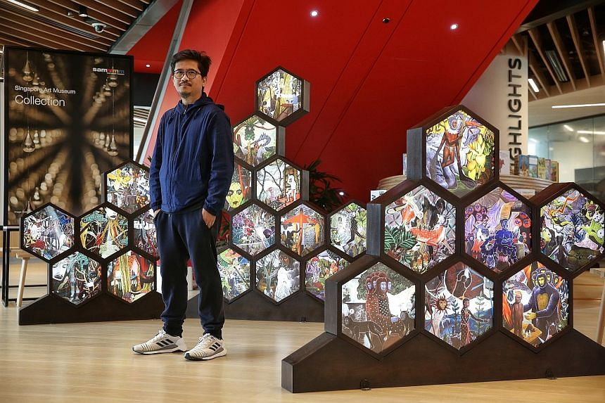 Filipino painter Rodel Tapaya's new installation - May Tainga Ang Lupa (2018), or The Land Has Ears - comprises more than 60 hexagonal lightboxes of scenes of his paintings.