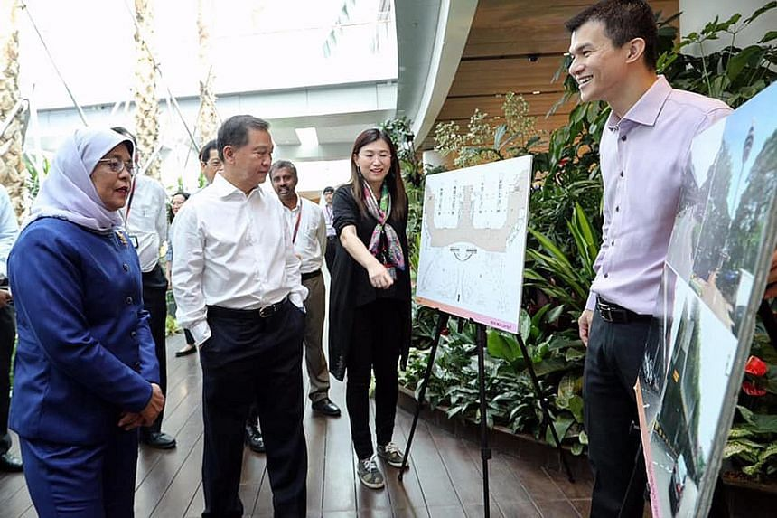 President Halimah Yacob, accompanied by Changi Airport Group (CAG) chairman Liew Mun Leong (in white shirt), visited Jewel Changi Airport yesterday morning, ahead of its official opening next week. While there, she met Ms Lim Peck Hoon, CAG's execut