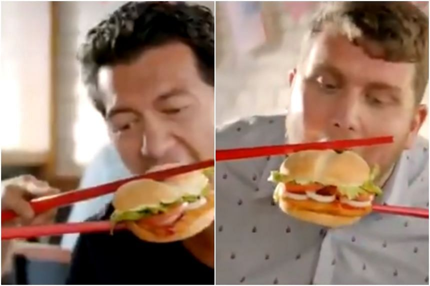 The fast-food chain's video clip showed diners very awkwardly trying to eat its new Vietnamese Sweet Chilli Tendercrisp burgers with giant red chopsticks.
