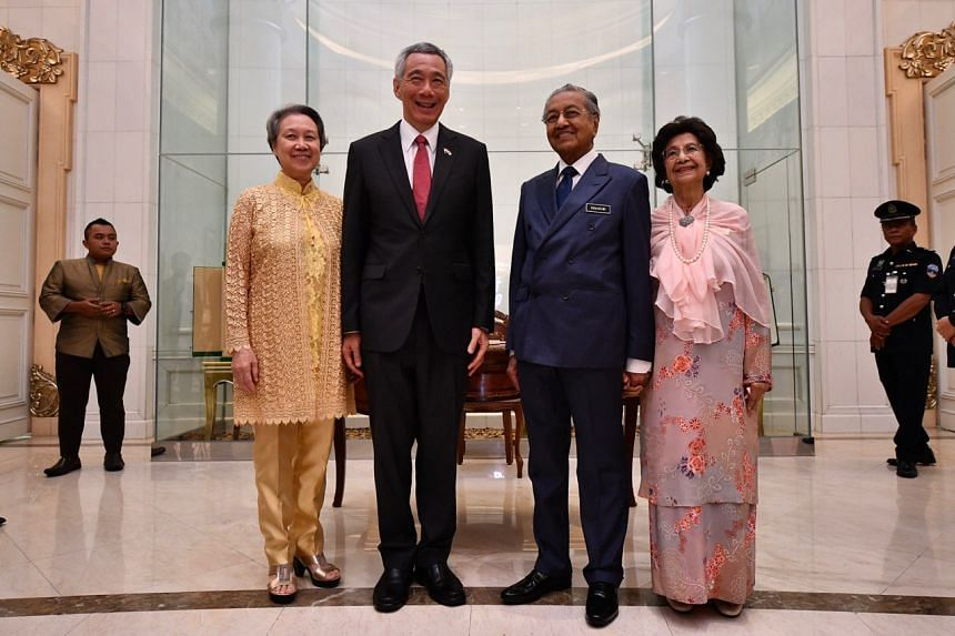 (From left) Mrs Lee, Prime Minister Lee Hsien Loong, Malaysian Prime Minister Mahathir Mohamad, and Tun Dr Siti Hasmah at the Protocol Gallery of the Seri Perdana in Putrajaya on April 9, 2019.