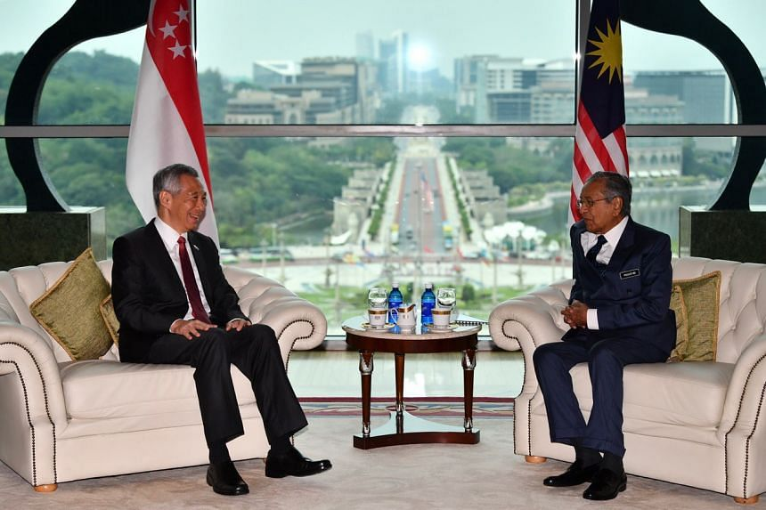 Prime Minister Lee Hsien Loong and his Malaysian counterpart Mahathir Mohamad at the Prime Minister's Office at the Perdana Putra Building in Putrajaya on April 9, 2019.