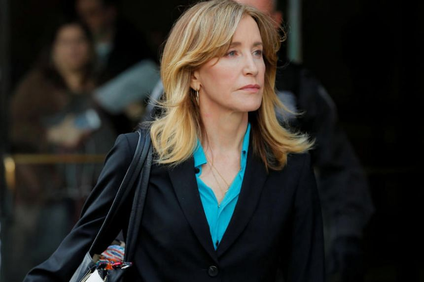 Actress Felicity Huffman, facing charges in a nationwide college admissions cheating scheme, leaves federal court in Boston, Massachusetts, US, on April 3, 2019.