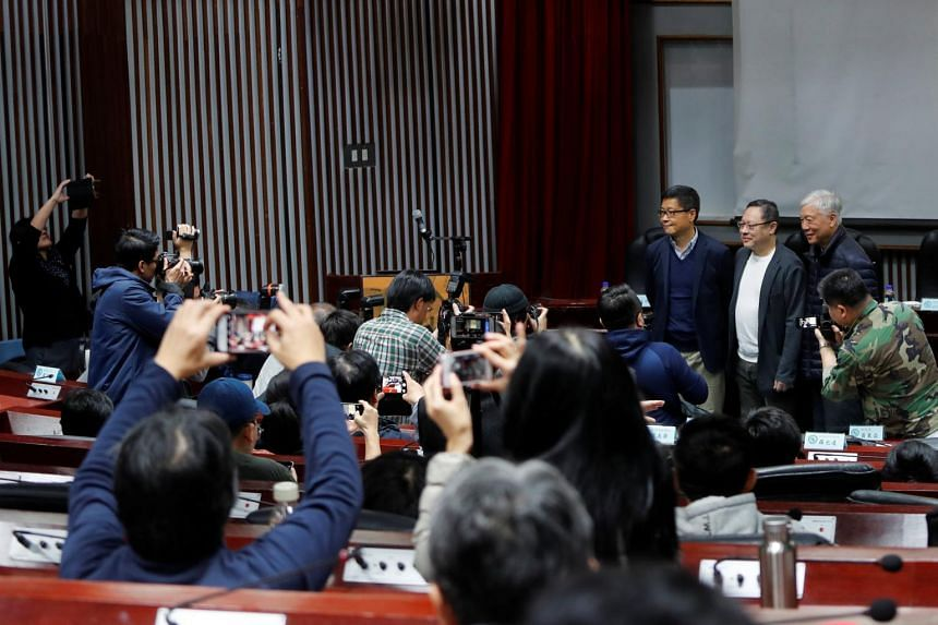 Media gather around Hong Kong's Occupy Central pro-democracy movement founders (from left) Chan Kin-man, Benny Tai and Chu Yiu-ming in Taipei, Taiwan, on Jan 29, 2019.