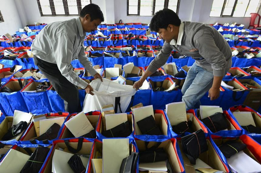 Indian officials arranging election materials ahead of polls, on April 8, 2019.