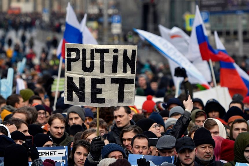 """Protesters at an opposition rally in central Moscow last month calling for Internet freedom in Russia. Individuals can be fined up to 400,000 roubles (S$8,320) for circulating false information online that leads to a """"mass violation of public order"""