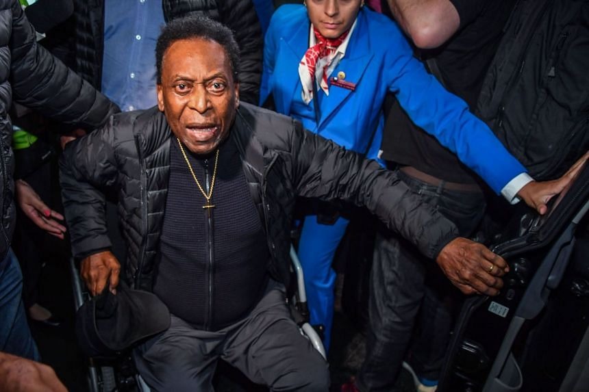 """Pele arrives back in Brazil after surgery in France for a """"severe urinary infection""""."""