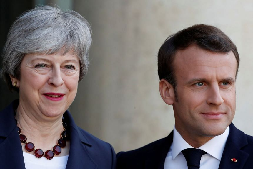 French President Emmanuel Macron welcomes British Prime Minister Theresa May in Paris.