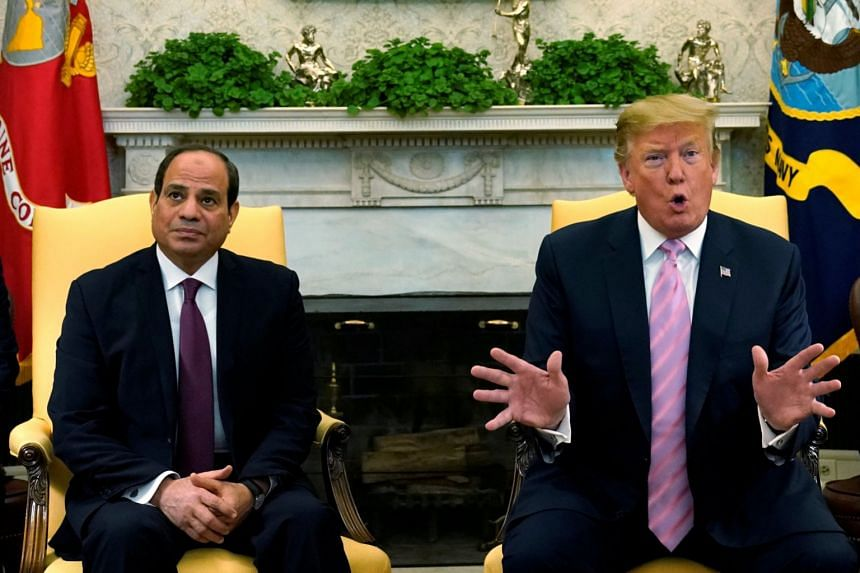 Trump speaks to the media with Egypt's Al-Sisi at the White House in Washington.