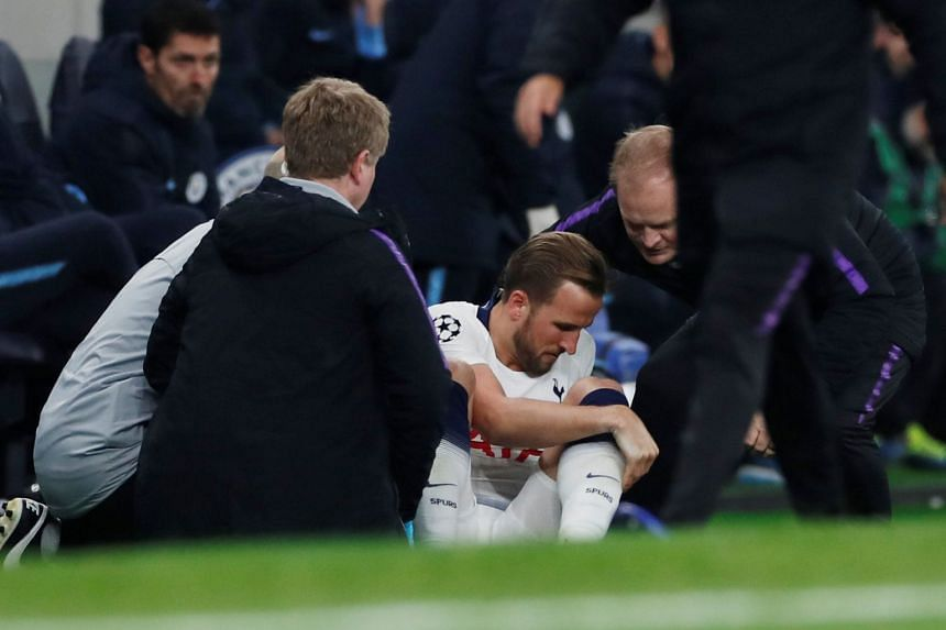 Tottenham's Harry Kane receives medical attention after sustaining an injury.