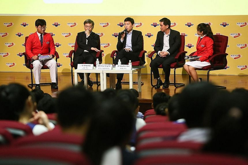 Associate Professor Gu Qingyang (second from left), Senior Minister of State for Trade and Industry Chee Hong Tat (centre) and Dr Tang Siew Mun speaking at a forum at River Valley High School yesterday.