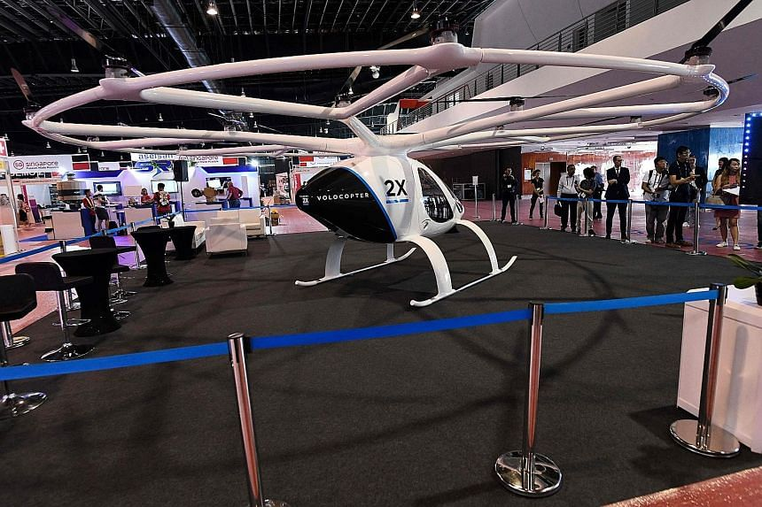 A Volocopter 2X on display at a media preview at the Rotorcraft Asia 2019 and Unmanned Systems Asia 2019 exhibition held at the Changi Exhibition Centre. The air taxis will initially take flight with a pilot, as it would be easier for the company to