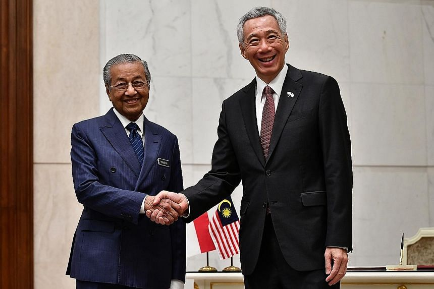 Prime Minister Lee Hsien Loong and Malaysian Prime Minister Mahathir Mohamad at Perdana Putra in Putrajaya yesterday. Both leaders discussed current bilateral issues, including airspace and maritime boundaries.