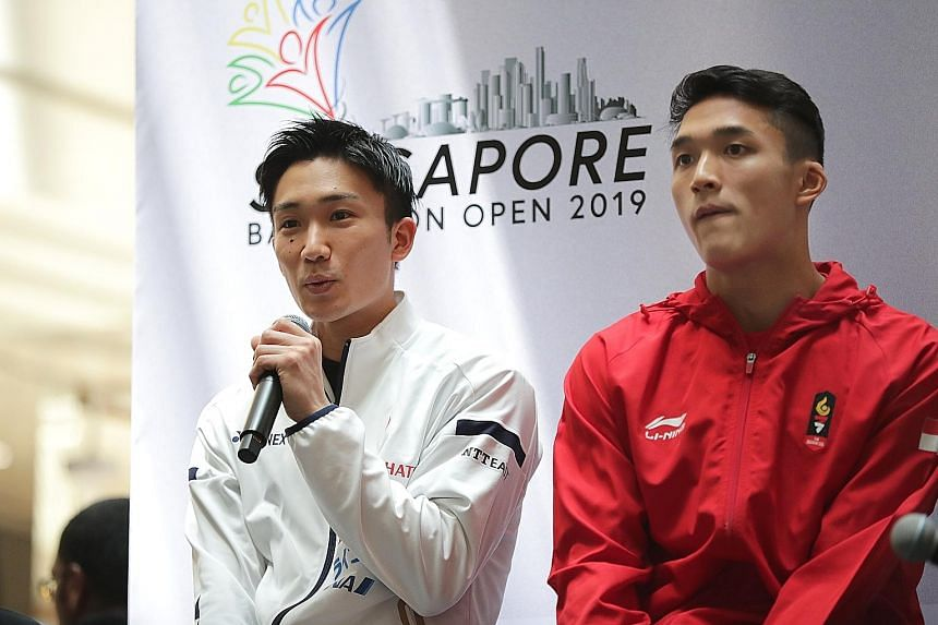 Japan's world champion Kento Momota speaking at a public press conference alongside Jonatan Christie at Wisma Atria yesterday. Both players begin their Singapore Open campaigns today.