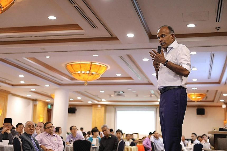 Law and Home Affairs Minister K. Shanmugam speaking at an event organised by the Association of Muslim Lawyers and social enterprise Wise SG yesterday to discuss hate speech and deliberate online falsehoods.