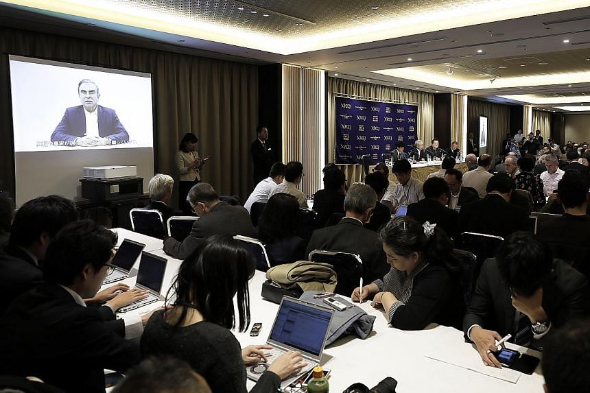 Ousted Nissan Motor chairman Carlos Ghosn's video message being played at a news conference at the Foreign Correspondents' Club of Japan in Tokyo yesterday. In the video, which was recorded before his arrest last week, he blamed Nissan's executives o