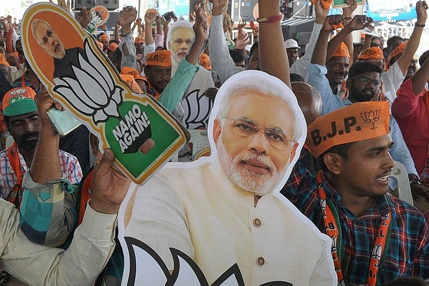 Supporters holding a picture of Indian Prime Minister Narendra Modi at a rally in Hyderabad yesterday. India is holding a general election to be held over nearly six weeks from tomorrow, when hundreds of millions of voters will cast ballots in the wo