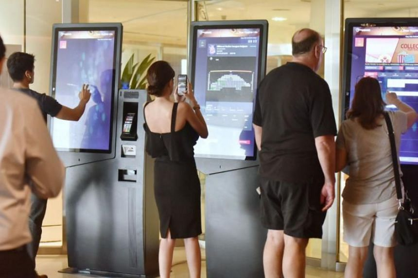 People at self-serving kiosks in Shaw Theatres Lido looking to get tickets for the Avengers: Endgame movie that opens on April 24.