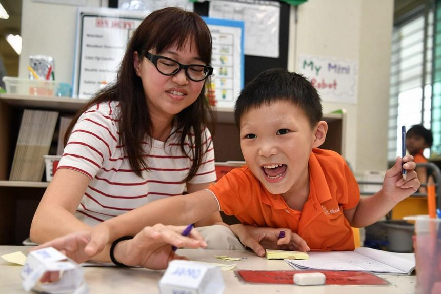 Learning Support Educator, Veronica Tang interacts with pupil, Elijah Wong at My First Skool.