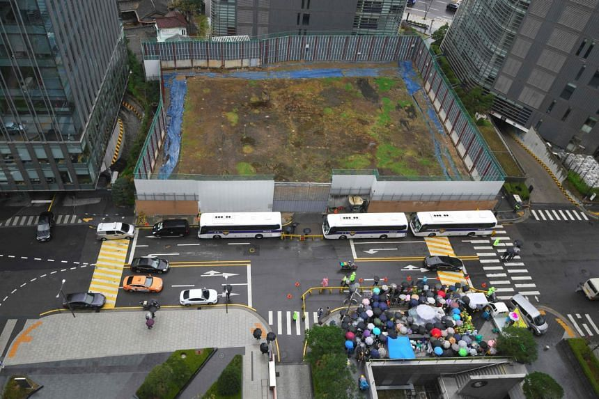 """The construction site where Japan's former embassy building used to be located, in Seoul, on April 10, 2019. Across the road, South Korean protesters hold a weekly anti-Japanese demonstration supporting """"comfort women""""."""