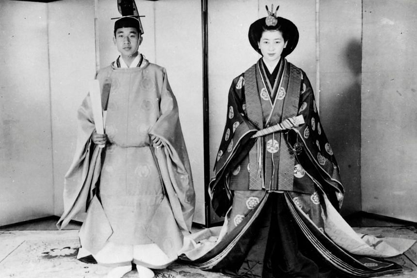 Japanese Emperor Akihito and Empress Michiko in their traditional wedding suits at the Imperial Palace in Tokyo on April 10, 1959.