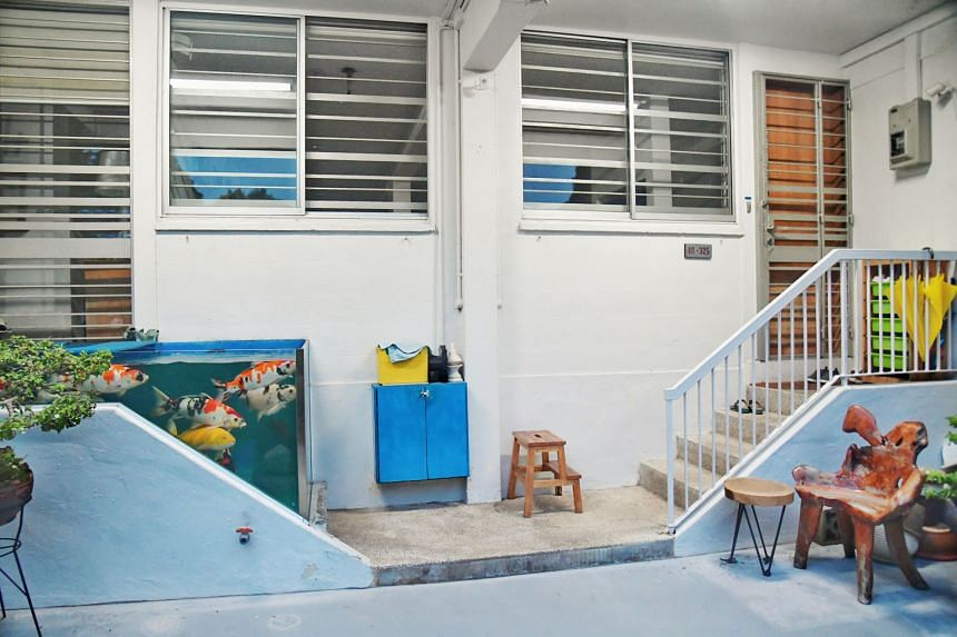 A flat owner who had converted his property's doorstep into a fish tank (above) for his koi carp has failed in his appeal to keep the structure. Tampines GRC MP Baey Yam Keng told ST that HDB and Tampines Town Council are exploring a plan to install