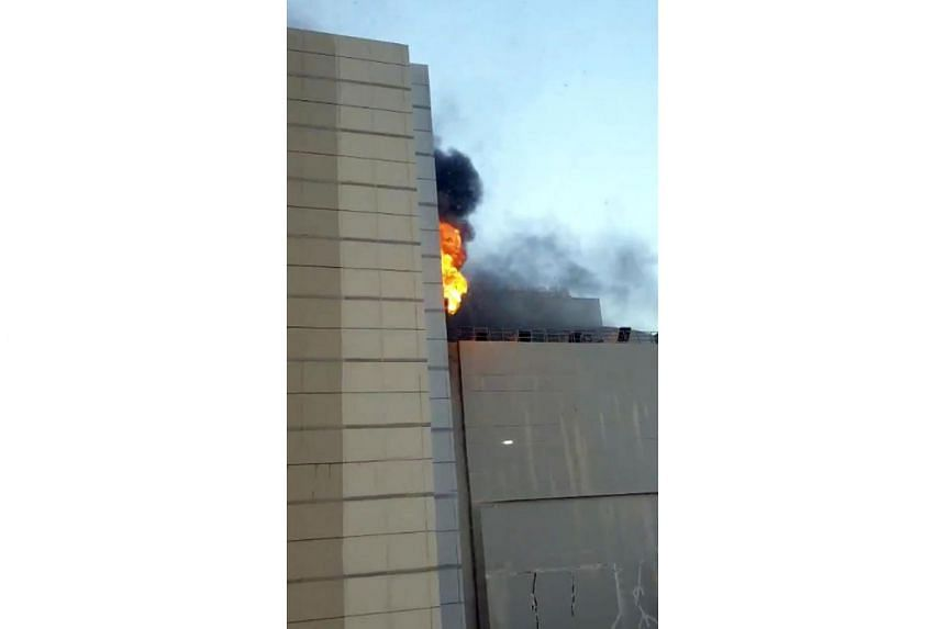 Flames and smoke from the blaze at a document storage room on the eighth floor of the mall was visible from a distance.