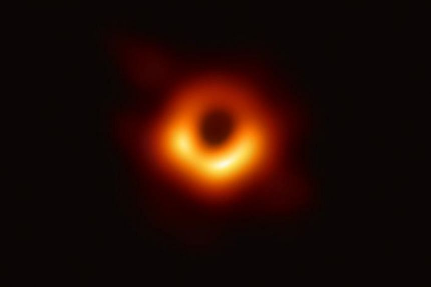 The first photograph of a black hole and its fiery halo, released by Event Horizon Telescope astronomers provided by the European Southern Observatory on April 10, 2019.