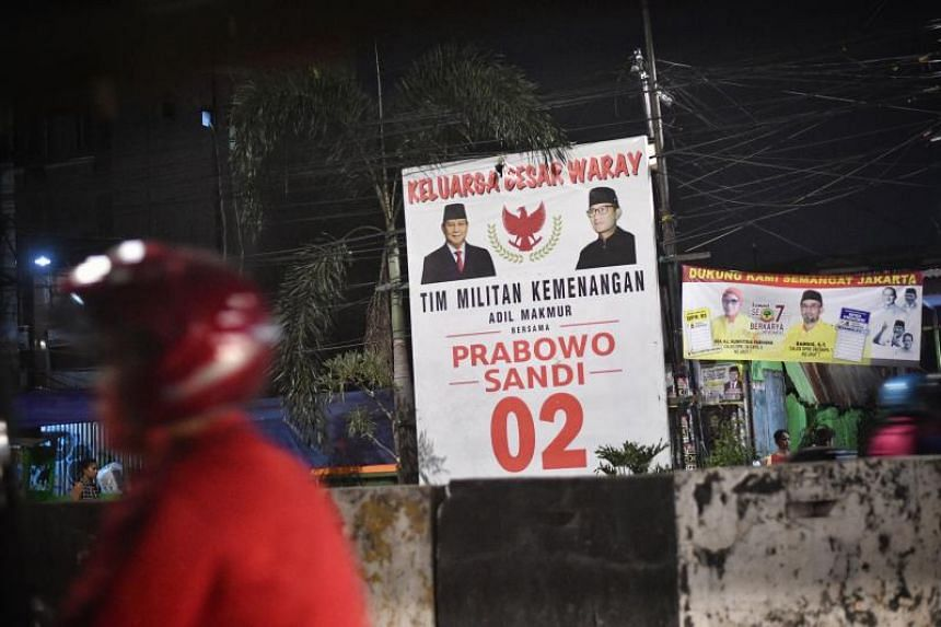 President Joko Widodo and his sole rival, former army general Prabowo Subianto, are No. 1 and No. 2 respectively on the ballot papers in the April 17 elections.