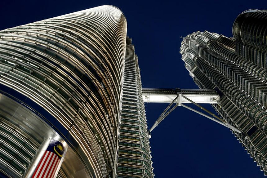 The Petronas Twin Towers in Kuala Lumpur. The international community labelled Malaysia one of Asia's Four Tigers, with Thailand, the Philippines and Indonesia making up the remaining three.