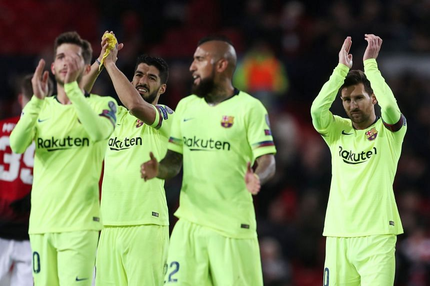 Barcelona's Lionel Messi, Luis Suarez and team mates applaud fans after the match.