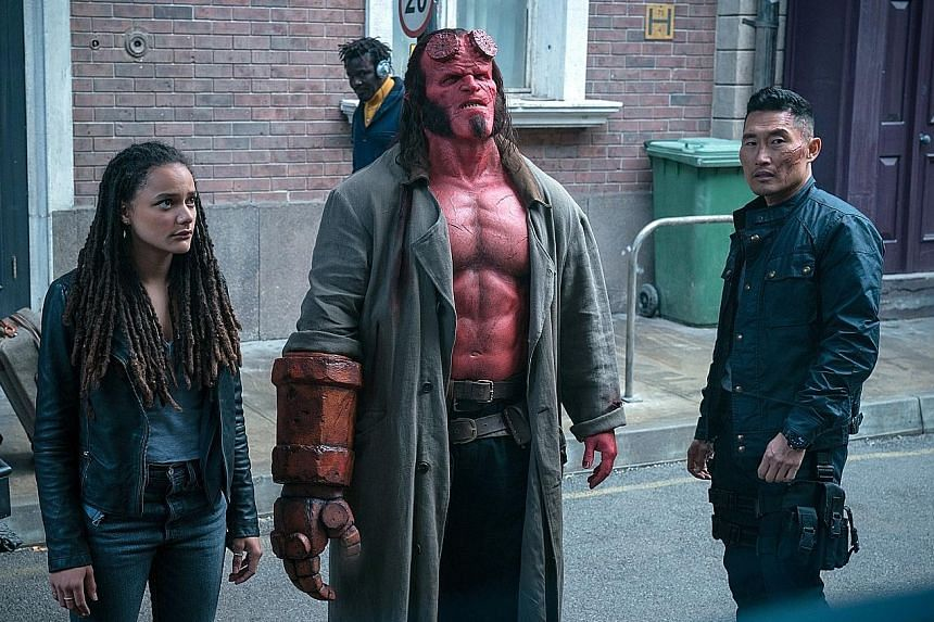 Hellboy stars (from left) Sasha Lane, David Harbour and Daniel Dae Kim.
