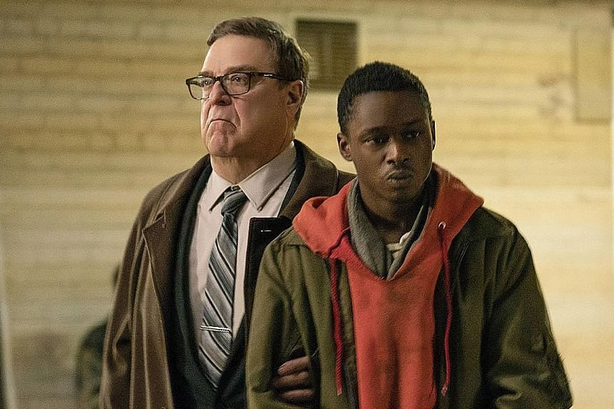 Captive State's John Goodman (left), who plays a police detective, and Ashton Sanders, a slave.