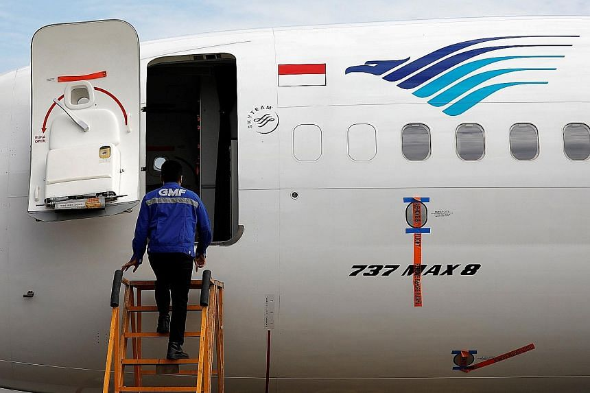 A technician prepares to check Garuda's grounded Boeing 737 Max 8 jet in Jakarta. Last month, the airline said that every month its B-737 Max 8 is laid up, it loses US$3 million.